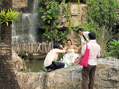 A popular wedding photo shoot at Dream World  Amusement Park in February 2010, Thanyaburi District, Pathum Thani Province, Thailand.